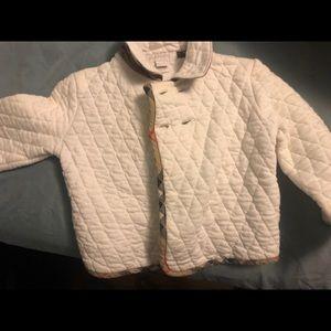 Softly worn unisex white Burberry jacket.